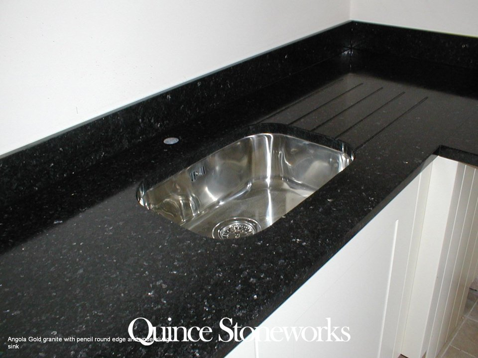 Angola Gold granite with pencil round edge and underslung sink