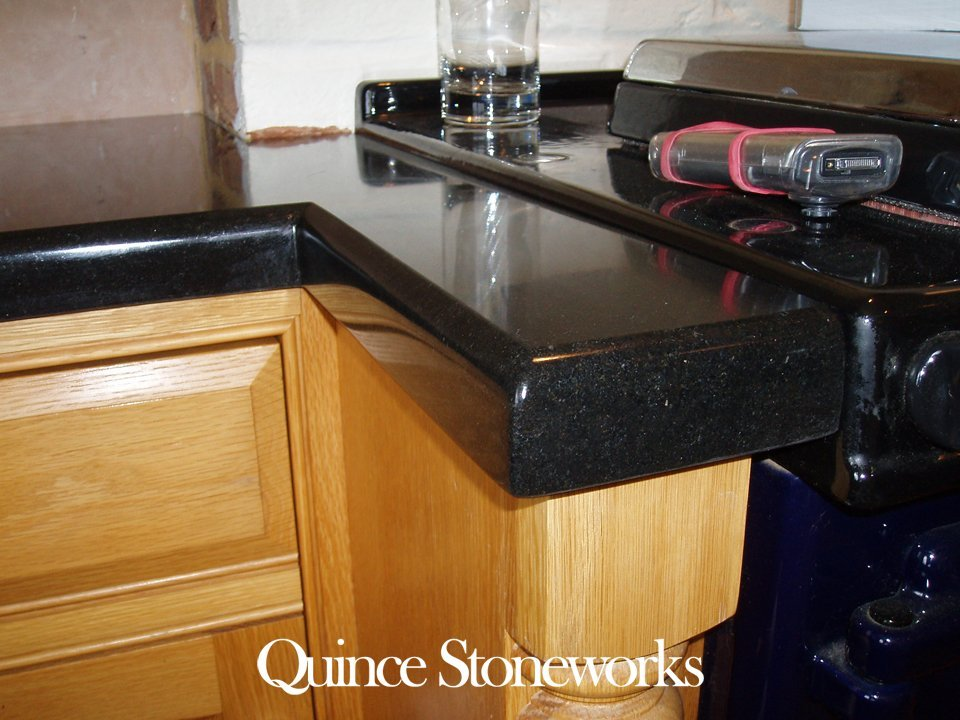 Close up of 40mm solid nero assoluto granite worktop