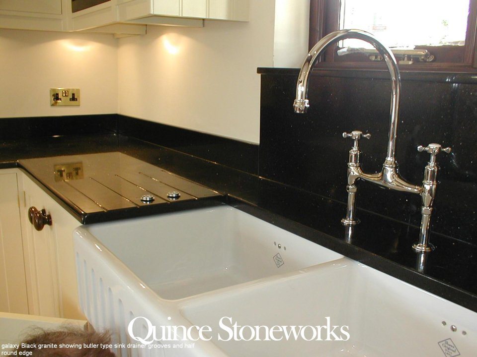 Galaxy Black granite showing butler type sink drainer grooves and half round edge