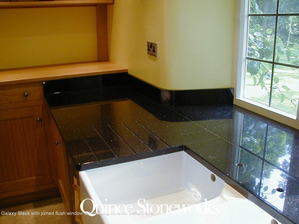 Galaxy Black with joined flush window sill showing ceramic belfast sink