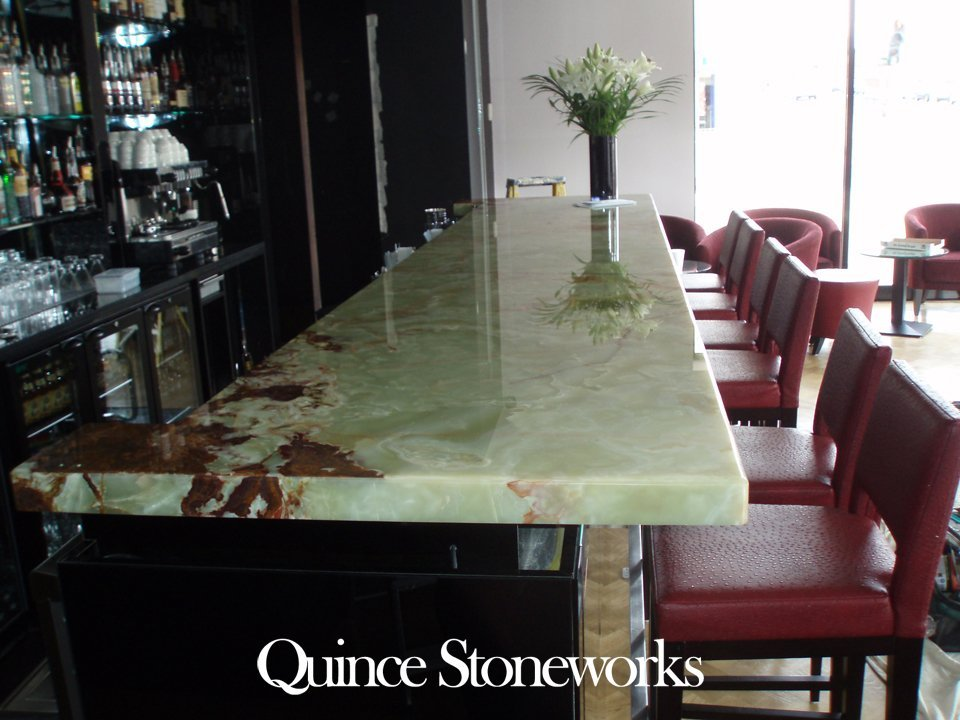 Green onyx bar top fitted to restaurant in Cambridge showing a 60mm mitred edge