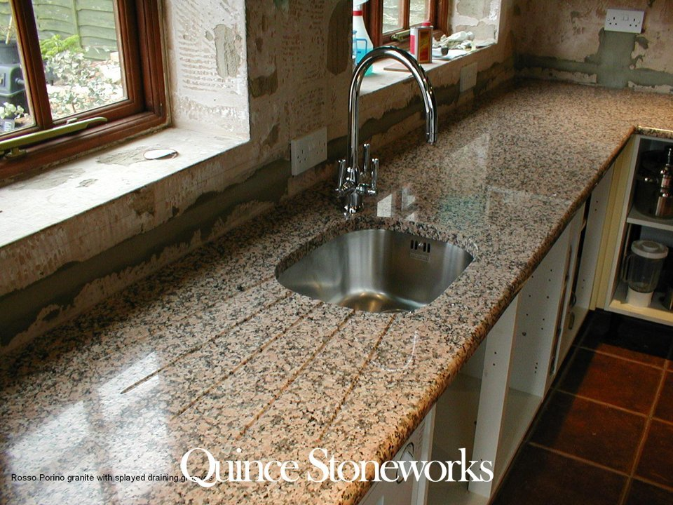 Rosso Porrino granite with splayed draining grooves