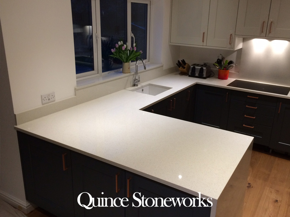 Silestone Bianco Stelline quartz worktop with mited downstand