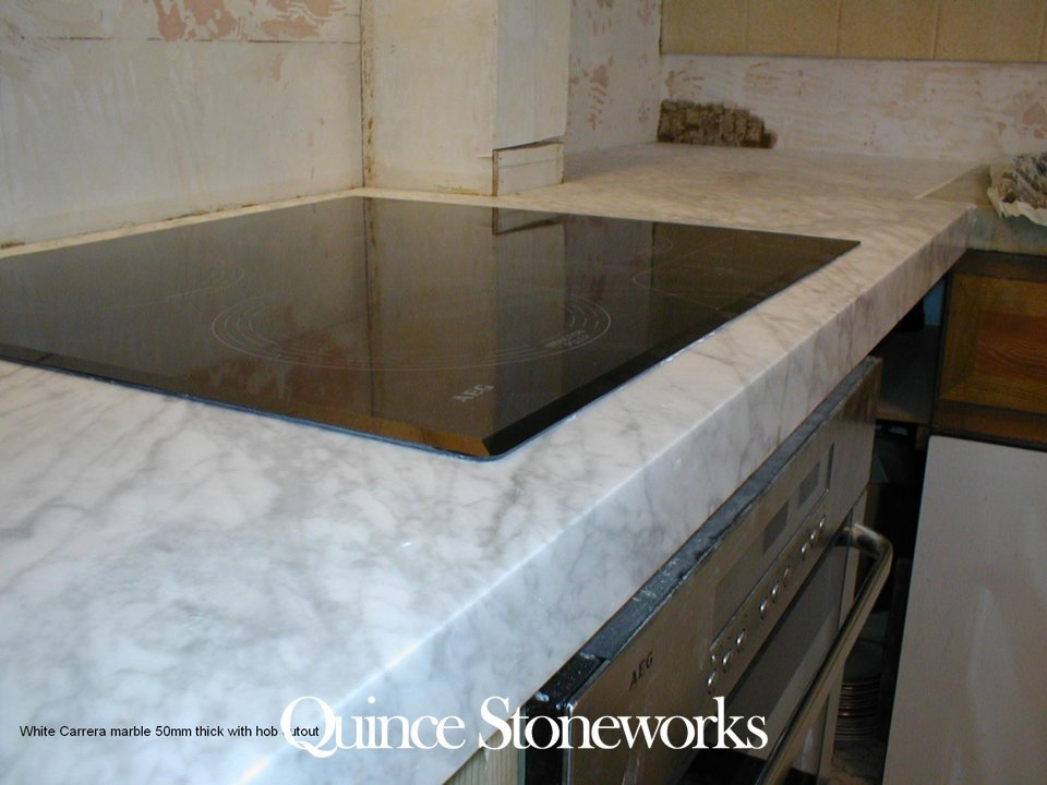 White Carrera marble 50mm thick with hob cutout